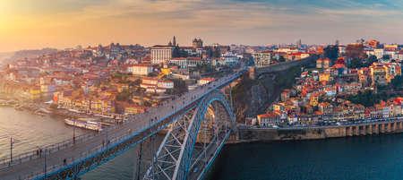 Porto panoramic aerial view of Dom Luis Bridge at sunset. Porto, Portugal. Cityscape of Porto downtown touristic Ribeira Фото со стока