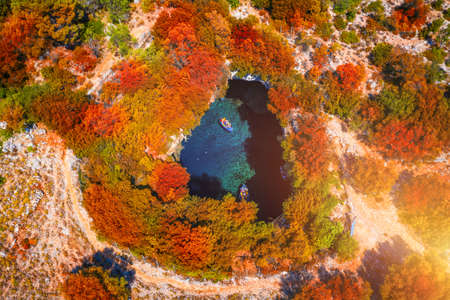 Melissani Cave with autumn colors. Famous Melissani lake on Kefalonia island, Karavomylos, Greece. On top of Melissani Cave (Melissani Lake) in Karavomylos village in Kefalonia island , Greece.