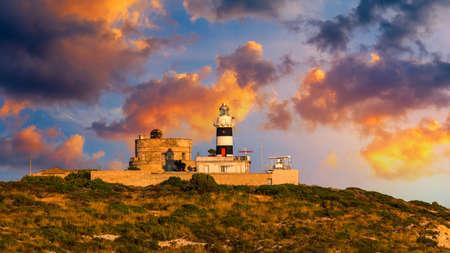 Capo Sant'Elia lighthouse and Calamosca tower. Cagliari, Sardinia, Italy. The Lighthouse of Capo Sant'Elia in Cagliari Sardinia at Sunrise