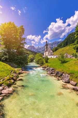 Parish Church of St. Sebastian in the village of Ramsau, Nationalpark Berchtesgadener Land, Upper Bavaria, Germany. Colorful view of Parish Church of St. Sebastian, Ramsau bei Berchtesgaden, Germany.