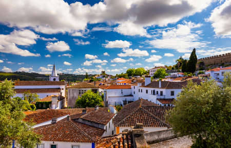 Historic walled town of Obidos, near Lisbon, Portugal. Beautiful streets of Obidos Medieval Town, Portugal. Street view of medieval fortress in Obidos. Portugal. Archivio Fotografico
