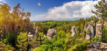 Prachov rocks (Prachovske skaly) in Cesky Raj region, Czech Republic. Sandstone rock formation in vibrant forest. Prachov Rocks, Czech: Prachovske skaly, in Bohemian Paradise, Czech Republic.