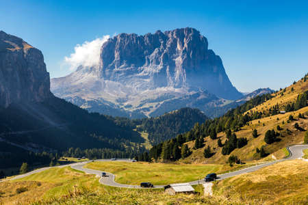 Gardena Pass, Trentino Alto Adige, Italy. Gardena Pass with Sassolungo mountain on the background. Passo Gardena, alpine pass between Val Badia and Val Gardena, South Tyrol, Italy.