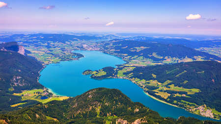 Amazing view from Schafberg by St. Sankt Wolfgang im in Salzkammergut, Haus house Schafbergspitze, lake Mondsee, Moonlake. Blue sky, alps mountains. Upper Austria, Salzburg, near Wolfgangsee, Attersee