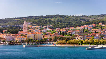 Supetar city in Brac island, Croatia. View from the sea. Picturesque scenic view on Supetar on Brac island, Croatia. Panoramic view on harbor of town Supetar from the side of sea. Brac, Croatia. 免版税图像