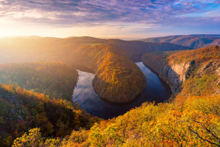 Beautiful Vyhlidka Maj, Lookout Maj, near Teletin, Czech Republic. Meander of the river Vltava surrounded by colorful autumn forest viewed from above. Tourist attraction in Czech landscape. Czechia. 免版税图像