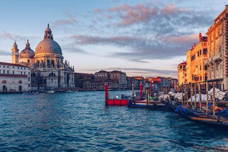 Santa Maria della Salute at Sunrise in Venice, Italy. Canal Grande sunrise of Accademia's bridge. Venice, Italy. Venetian background.