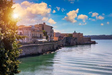 Siracusa, Ortigia Island, Sicily, Italy. Isola di Ortigia, coast of Ortigia island at city of Syracuse, Sicily, Italy. Coastline town Syracuse, Sicily and old Ortigia island.