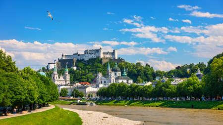 Panoramic view of Salzburg skyline with Fortress Hohensalzburg and river Salzach, Salzburger Land, Austria. Salzburg skyline with river Salzach in springtime, Austria.