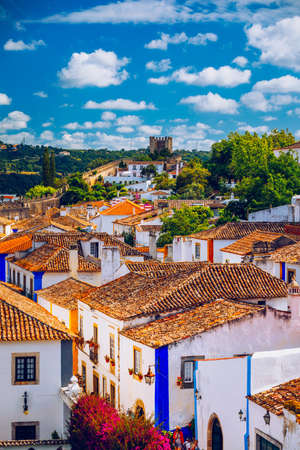 Historic walled town of Obidos, near Lisbon, Portugal. Beautiful streets of Obidos Medieval Town, Portugal. Street view of medieval fortress in Obidos. Portugal. Editoriali