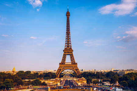 Eiffel tower in summer, Paris, France. Scenic panorama of the Eiffel tower under the blue sky. View of the Eiffel Tower in Paris, France in a beautiful summer day. Paris, France. Editoriali