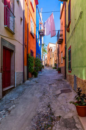 Street view of the beautiful village of Bosa with colored houses and a medieval castle. Bosa is located in the north-wesh of Sardinia, Italy. Street view of colorful houses in Bosa village, Sardegna.