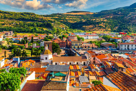 Aerial view of the beautiful village of Bosa with colored houses and a medieval castle. Bosa is located in the north-wesh of Sardinia, Italy. Aerial view of colorful houses in Bosa village, Sardegna. Editoriali