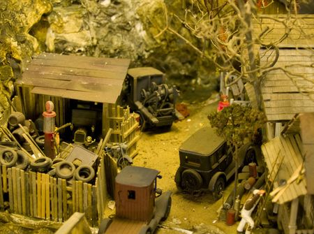 My Dad built every single part of this little town by hand. Board by board for the buildings rock trees etc. Fine Detail. He was one of the best. You would be hard pressed to find any better model rail road photos on the internet including the high dollar photo