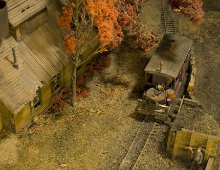 Model railroad showing train arriving and ready to be filled with coal. Train Station is to the left.