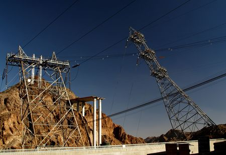 Really cool image of the Hoover Dam Power Lines. You see them coming up to the valley straight but when they go down into the canyon they built them on angles. See the horizontal walkway and you can see how much they angled them.  photo