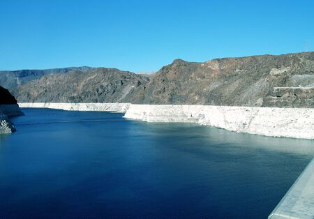 This is the top lake side of the Hoover Dam. See how far the water is down? This is just a few days after letting it out to artificially flood the bottom of the Colorado River. They are doing this to recreate what was long ago and redistribute banks of sa photo