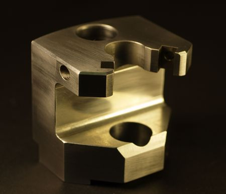 This is a picture of a custom milled or machined part. Machine shops use manufacture these types of custom parts with CNC machines, lathes, mills and turning centers.