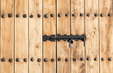 windows and doors: Windows doors of wood closed with a padlock