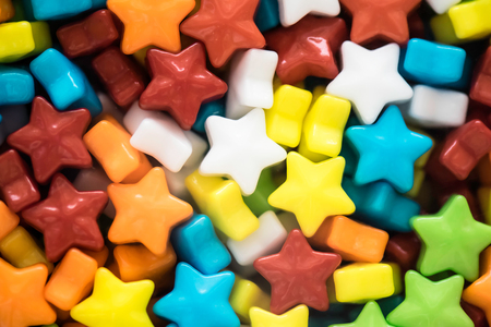 jellybean: A lot of multicolored little star shape candies closeup