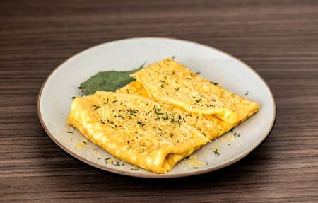 scramble: Delicious breakfast dish of omelette with parmesan cheese and thyme