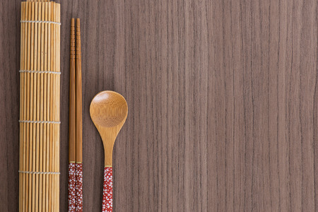 wood stick: Pink decorated sushi bamboo chopsticks and spoon Stock Photo