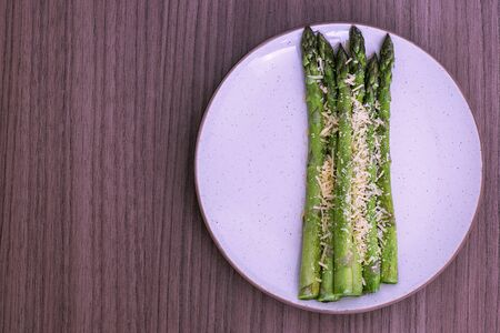 Delicious fresh roasted asparagus whit parmesan cheese