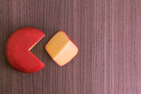 s video: A quarter of Dutch cheese cut over wood Stock Photo
