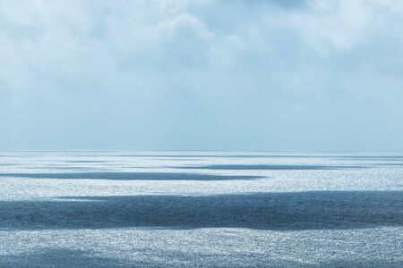 oceana: Beautiful horizon over the sea with highlights and shadows reflected over water