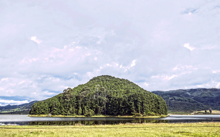 Nice small island formed on the waters of the Neusa reservoir in Cundinamarca Colombia.