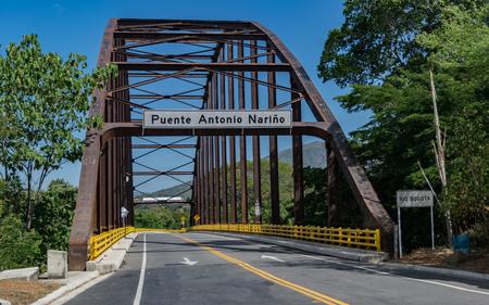 Photograph on the new bridge over de Bogota river that connects Tocaima with Agua de Dios, Cundinamarca, Colombia Reklamní fotografie