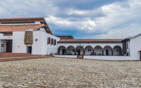 GUATAVITA CUNDINAMARCA, COLOMBIA - DECEMBER 26, 2017: Beautiful colonial architecture of the towns central park.