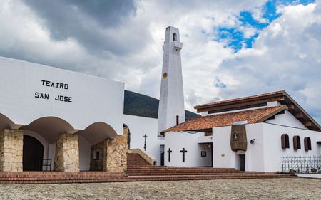 GUATAVITA CUNDINAMARCA, COLOMBIA - DECEMBER 26, 2017: Beautiful colonial architecture of the towns central park and its church.
