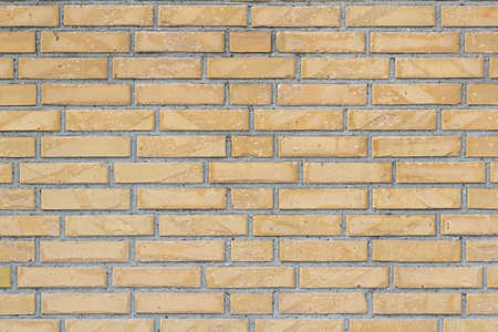 Yellow brick wall for texture or background, horizontal