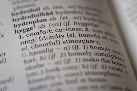 Close up of dictionary with the Danish word hygge translated to English