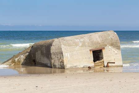 German World War II bunker half submerged, Skiveren beach, Denmark