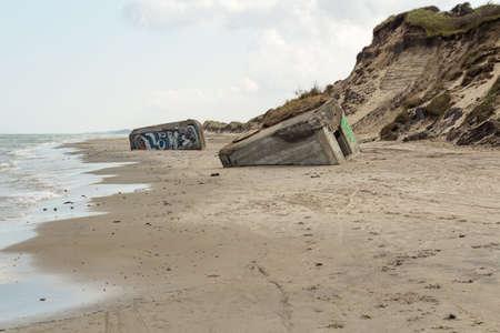 German World War II bunkers sinking into the sand, Skiveren beach, Denmark