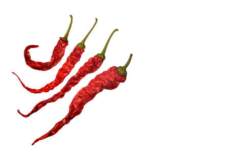 Red peppers as though running or dancing on white background.