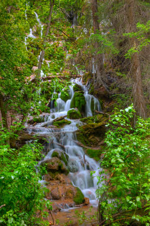 Mountain stream flowing from Hanging Lake along a trail in central Colorado.