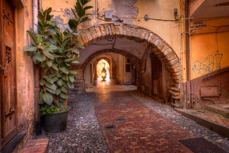 Sanremo, Italy - 05252016 - One of the old scenic narrow streets of historic Sanremo, Italy
