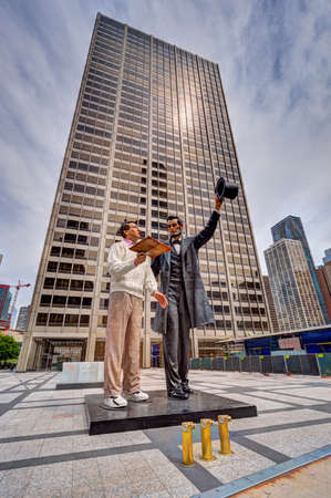abraham: Chicago, Illinois, USA, 06112017: Return Visit by artist Seward Johnson in exhibit in downtown Chicago.  Abraham Lincoln is depicted discussing the Gettysburg Address with a modern man.  This is an enlarged version of the original which was produced f Editorial