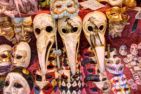 Venice Italy - 05222017: Venetian carnival masks on display in a shop window in Venice featuring medieval plague doctor masks. Editorial