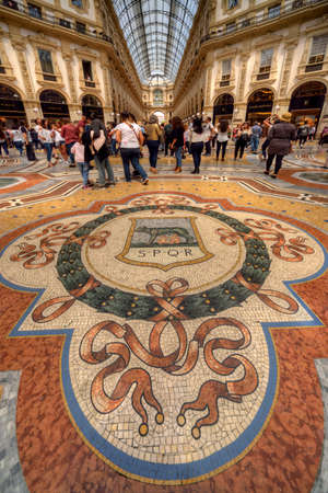 Milan, Italy - 05202017: Mosaic Floor in the Galleria Vittorio Emanuele II shopping gallery in Milan. It shows Romulus & Remus, the legendary founders of Rome, suckled by a wolf. Editorial