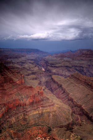 Grand Canyon with rain storm approaching.  Vertical (portrait) format. Stock Photo
