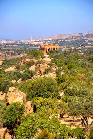 Distant View of the Concordia temple in the Valley of temples near Agrigento in Sicily, Italy. (vertical frame)