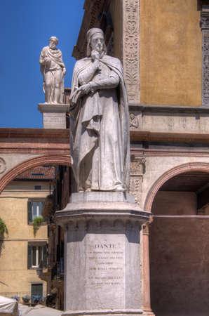 Verona, Italy - May 21, 2017: Statue of Dante Alighieri in Piazza Dante, Verona, Italy.  Dante is known for his work Divine Comedy.
