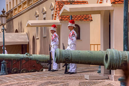 Monte Carlo, Monaco, French Riviera - May 26, 2016: Guards and cannons at the Prince's Palace on Palace Square in Monte Carlo, Monaco.