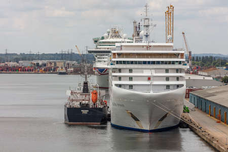 Silver Spirit cruise ship docked in Southampton port and being refueled by fueling ship. Some other cruise ship in the background.