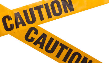 Yellow caution tapes crossing. Isolated. White background. Protection against viruses, bacteria, and germs. Quarantine area. Police barrier.