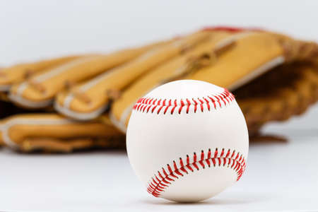 Professional leather baseball and glove isolated on white background.